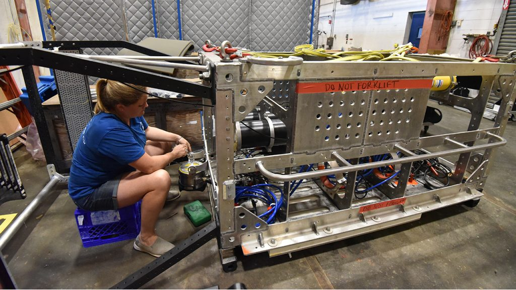 WHOI engineer working on dee-see vehicle