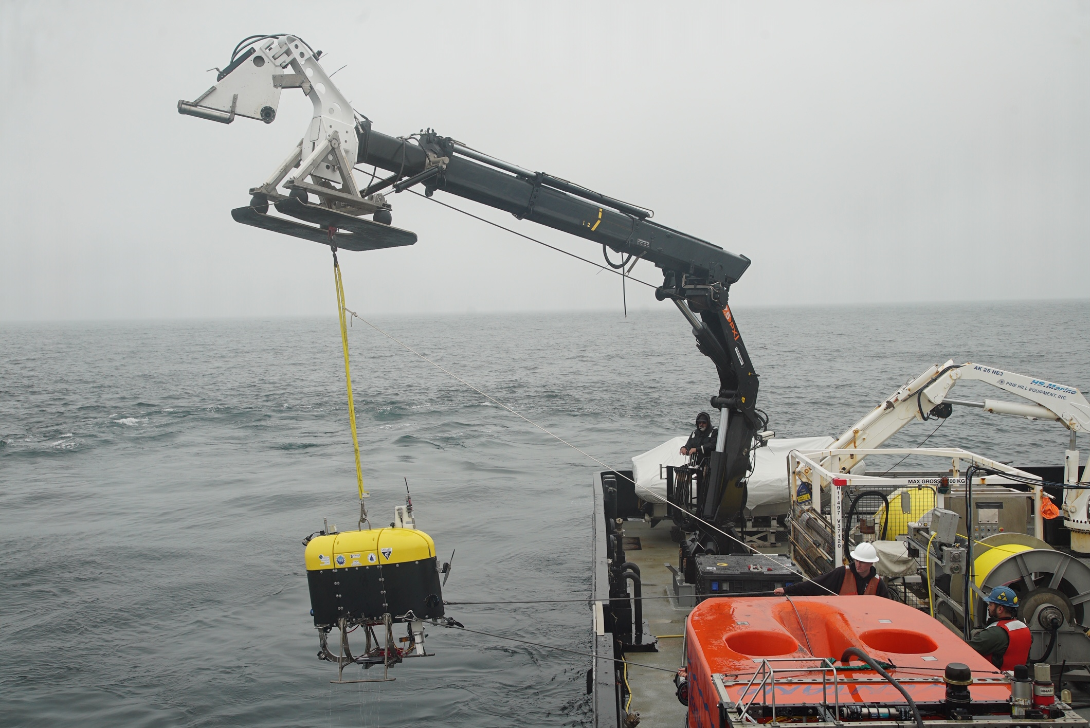 Mesobot is hoisted over the side of a research vessel