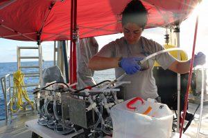 An OTZ research assistant prepares an eDNA sampler for deployment.