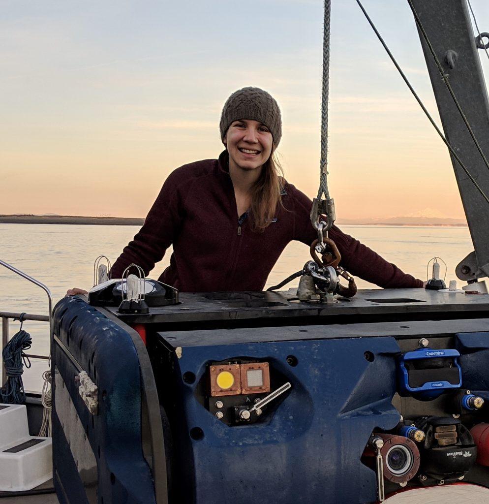 WHOI engineer Emma Cotter with the Adaptable Monitoring Package, an instrumentation platform developed at the University of Washington for environmental monitoring at marine renewable energy sites. Photo Credit: James Joslin (APL/UW)