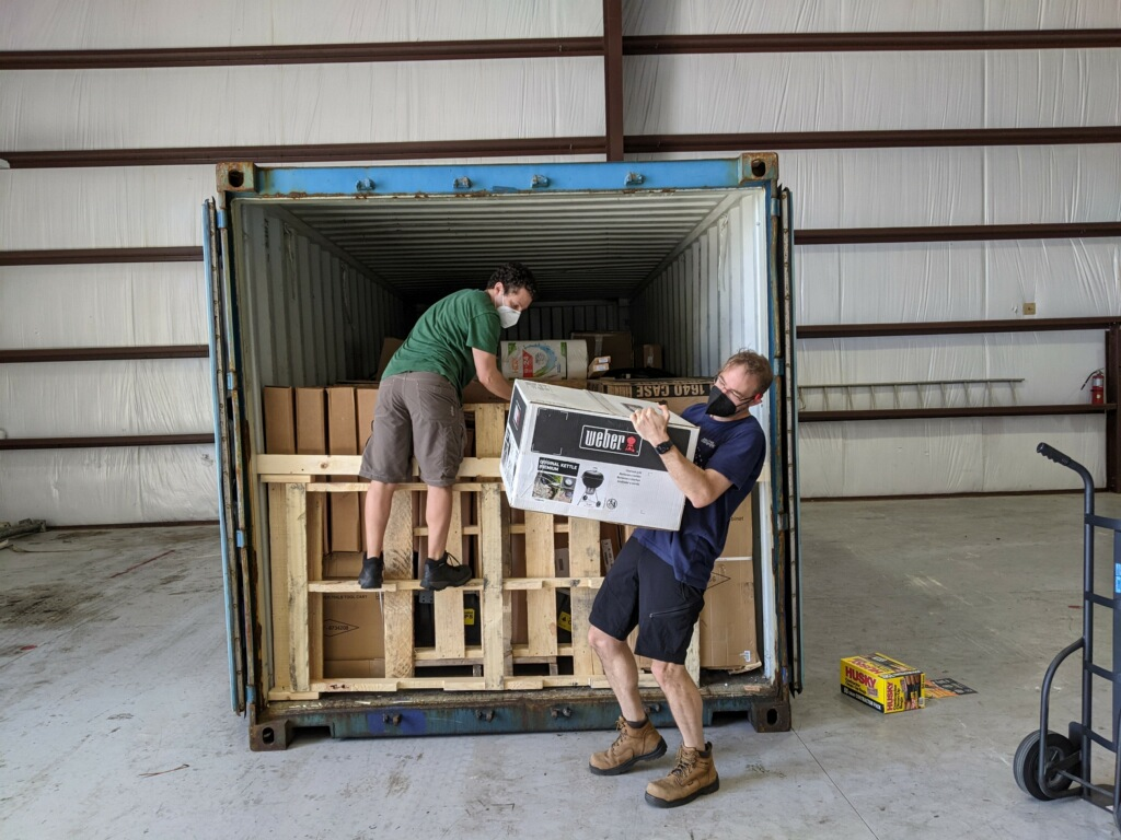 OTZ Team members Jacob Bernstein (left) and Allen Adams (right) carefully unload scientific gear in Bermuda. (When you're leaving New England for a balmy island, bringing a grill is practically required.)