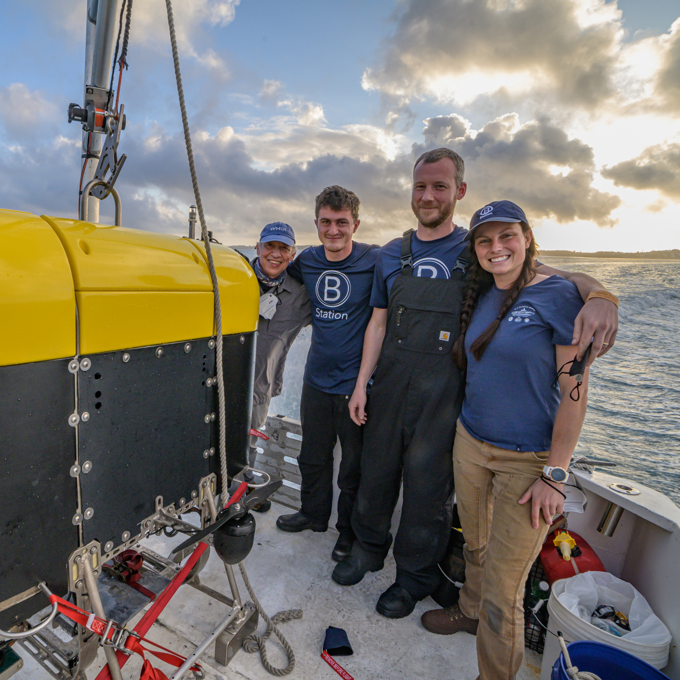 OTZ scientists and engineers Dana Yoerger, William Pardis, Eric Hayden, and Molly Curran (left to right) pose next to Mesobot, an autonomous underwater vehicle built to explore life in the twilight zone, as it undergoes testing in Bermuda.