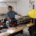 Engineer Jordan Stanway troubleshoots a problem in one of Mesobot's motors.