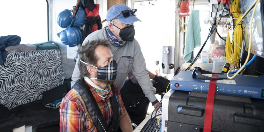 WHOI Senior Scientist Dana Yoerger (right) and Engineer Jordan Stanway (left) review <em>Mesobot</em>'s dive plan before its first deep-water deployment. Instructions to the vehicle can be pre-programmed before sending it on its way.  Credit: Jennifer Berglund