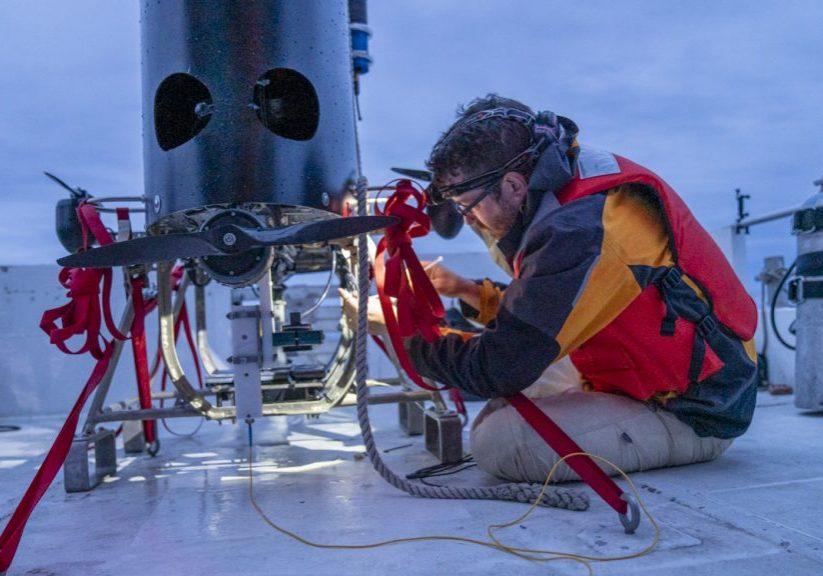 Research Technician Fredrick Marin straps down Mesobot as dawn breaks. (Photo: Jennifer Berglund)