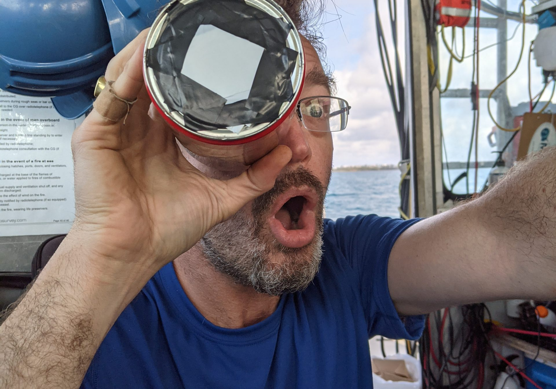 """Allan Adams wows us with his DIY radiometer filter, scrapped together from an empty Illy coffee can. """"The Illy can has now been retired to the MacGyver Hall of Fame,"""" said Senior Scientist Dana Yoerger. (Photo: Dana Yoerger.)"""