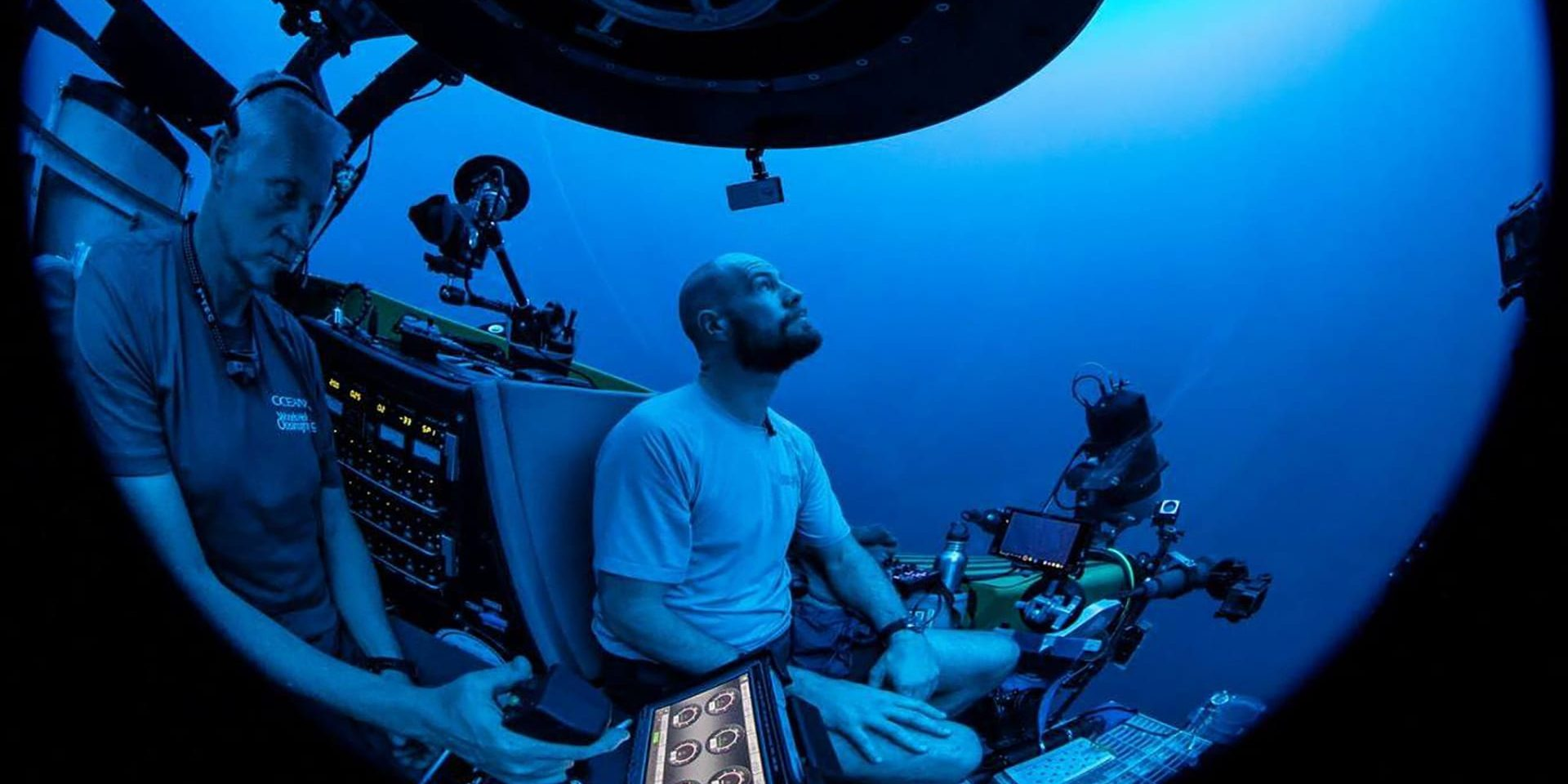 Paul Caiger descends to the ocean twilight zone on the OceanX submersible, Nadir, with pilot Alan Scott at the controls. (Photo by © OceanX Media)