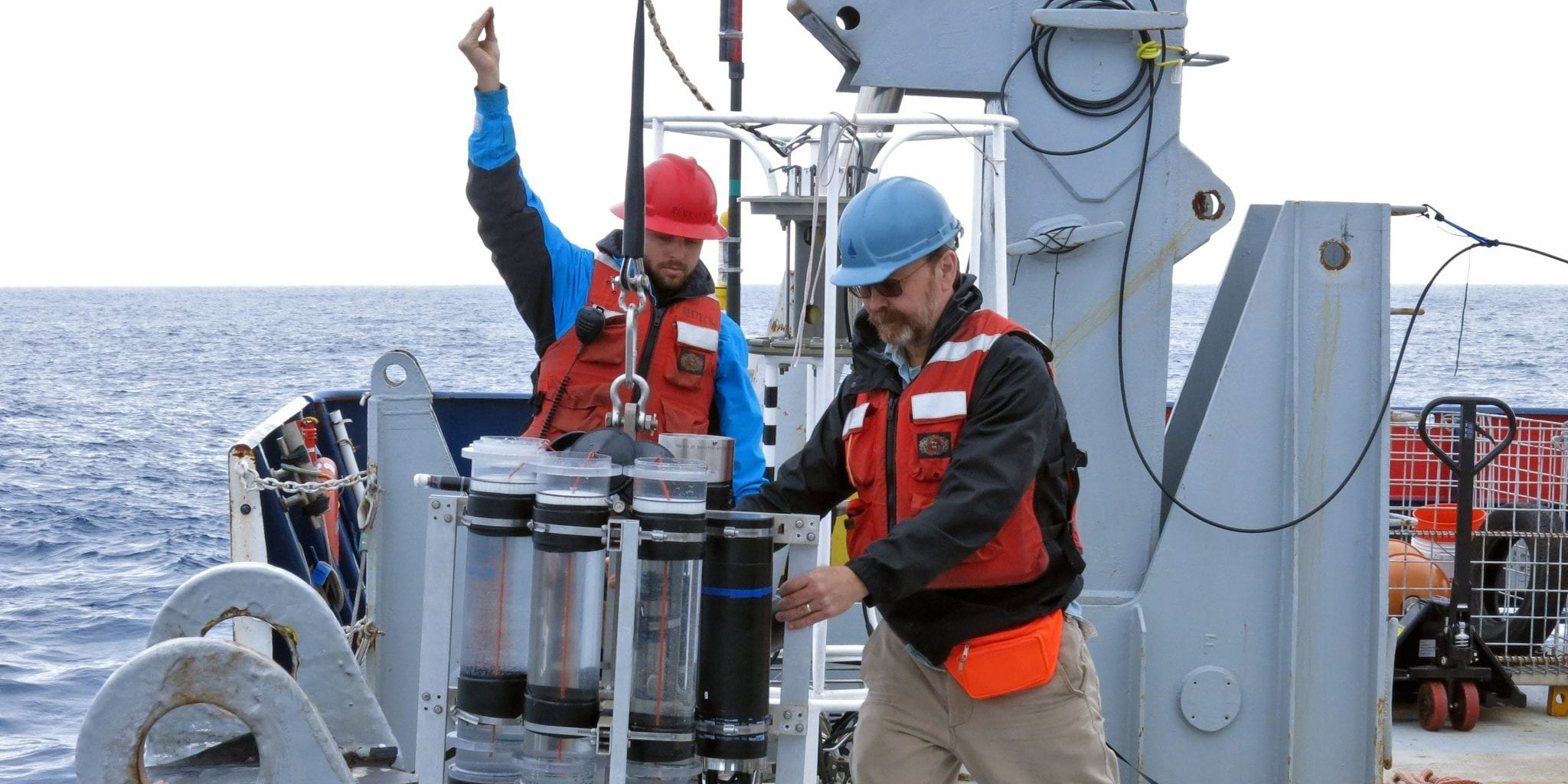 WHOI Scientist Ken Buesseler deploys a sediment trap