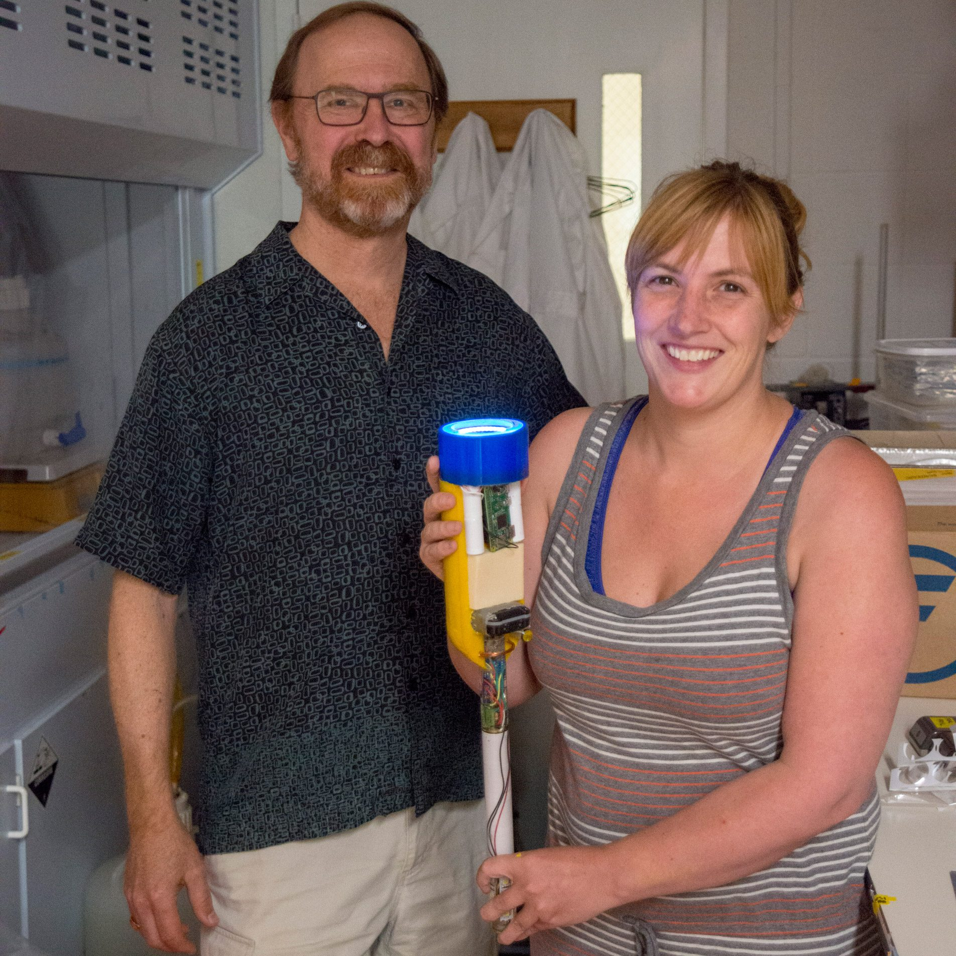 Ken Buessler and Melissa Omand with newly developed Minion.  Photo by Tom Kleindinst, Woods Hole Oceanographic Institution.